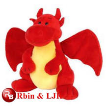 Juguete de peluche dragón rojo