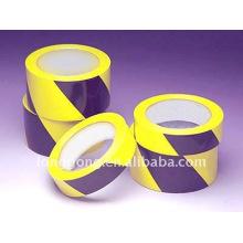 Fita vermelha e amarela do cuidado do PVC