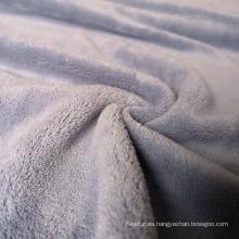 Tela barata del paño grueso y suave de coral del poliéster para las mantas