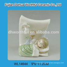Ceramic decoration with baby figure