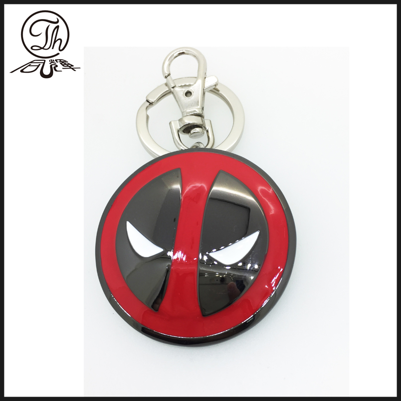 The Marvel Deadpool shield metal key rings