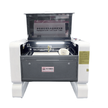 Multifunction CNC co2 laser cutting machine 100w co2 laser engraving cutting machine for acrylic crystal leather rubber wood