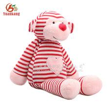 Mono de peluche mono rosa y rojo con corazón de amor de bordado