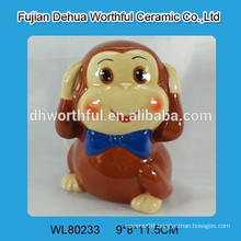 Painted ceramic monkey money bank