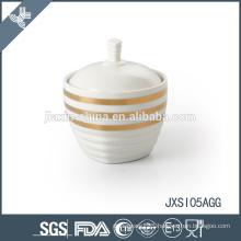 white porcelain sugar pot, cookies tins, small candy can, sugar pot