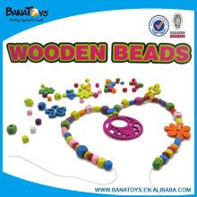 Juguetes de madera de las niñas del collar del grano