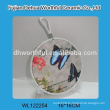 Porta vasos de cerámica popular en forma de mariposa