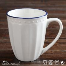 White Porcelain Embossed Blue Rim Mug