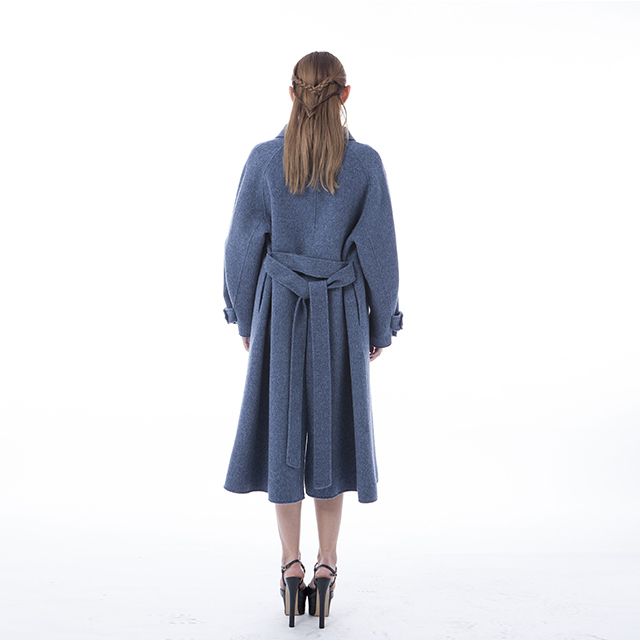 The cashmere coat comes with a belt at the back