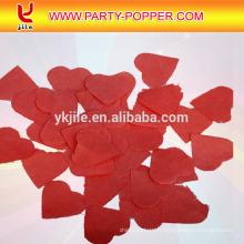 Confetti rose et rouge de papier de soie de forme de coeur pour la réception de mariage