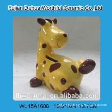 Painting ceramic giraffe piggy bank