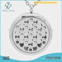 Fashion design round hole locket,stainless steel wholesale locket,medium perfume locket