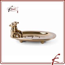 Plato de jabón de baño de cerámica con forma de grifo de chapa dorada