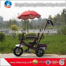 Лучший трехколесный велосипед для малышей с навесом и нажимным стержнем