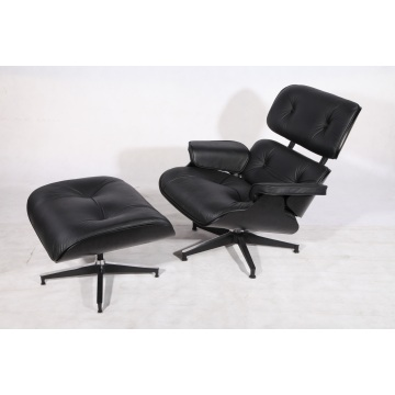 Svart plywood Eames Lounge Chair och Ottoman