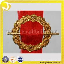 golden flower-shaped curtain buckle