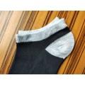 Lady's black and white socks