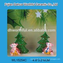 Velas hechas a mano de la Navidad con la estatua del mono para la decoración casera