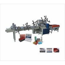 Heat shrinkable film packaging machine