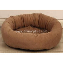 A brown round pet beds