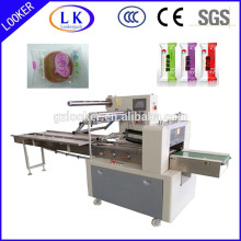 Horizontal flow packing machine for regular solid object pillow bag packing