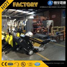 Máquina pulidora y rectificadora de suelos de superficie de hormigón