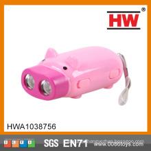 Karikatur-Entwurfs-Rosa-Schwein-Hand, die Taschenlampe drückt