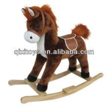 caballo de peluche con vaquero de la música