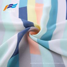 Tela impresa 100% poliéster colorida de los vestidos de las muchachas