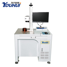 Machine à éplucher de la source laser