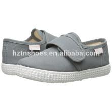 China Preço baixo Atacado Calçados de lona Kids Injeção Casual Flat Shoe