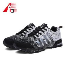 Novo estilo Fly malha sapatos sapatos de desporto respirável