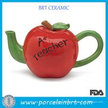 Tetera de manzana de cerámica con mango verde de cuerpo rojo