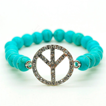 Turquoise 8MM Round Beads Stretch Gemstone Bracelet with Diamante Peace logo Piece