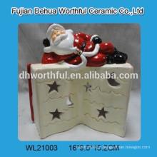 Lovely santa com livro de cerâmica levou luz de Natal