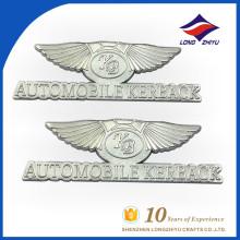 Plat personnalisé en forme d'aile en métal personnalisé avec logo