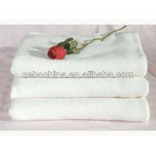 Venda quente 100 por cento algodão branco toalha de praia por atacado