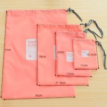 Set of 4 nylon drawstring toiletry pouches
