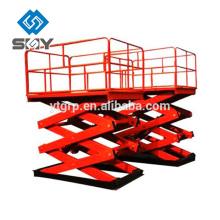 Pequeña mesa elevadora de tijera