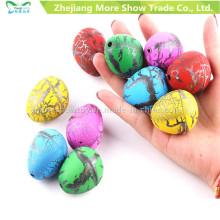 60PCS huevos de dinosaurio de agua tamaño pequeño huevos crecientes huevos de juguete