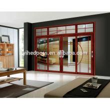 Grande porte coulissante en aluminium pêche rouge pour le salon