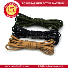 Durable long life reflective string for garment