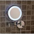 Espejo de maquillaje montado en la pared con luz LED utilizado en el baño