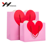 2016 en gros en forme de coeur carton recyclable personnalisé sac cadeau avec poignées