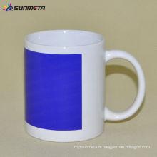 Tasse blanche de sublimation de 11 oz avec couleur de patch bleu Changement de Sunmeta en yiwu