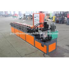 Machine de formage de rouleaux de porte de garage en acier, machine de fabrication d'obturateur de porte de garage métallique