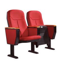 стул аудитории с блокнотом и подлокотником