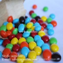 Distribuidores de chocolate cacahuetes dentro chocolate bola