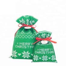 Bolsa de regalo con cordón de Navidad verde no tejida