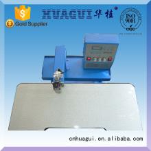 HUAGUI nueva cortadora de tela para la tela del bordado